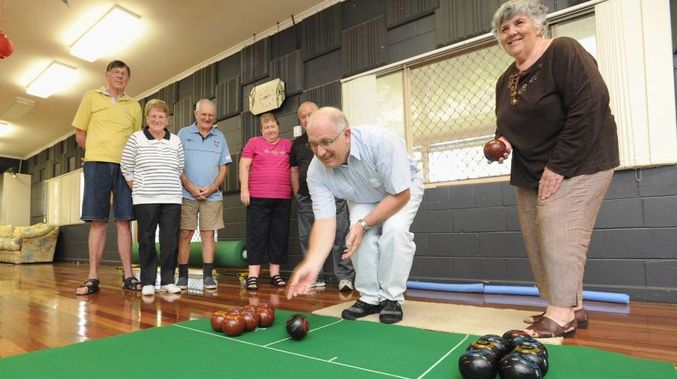 Indoor bowls - people bowling